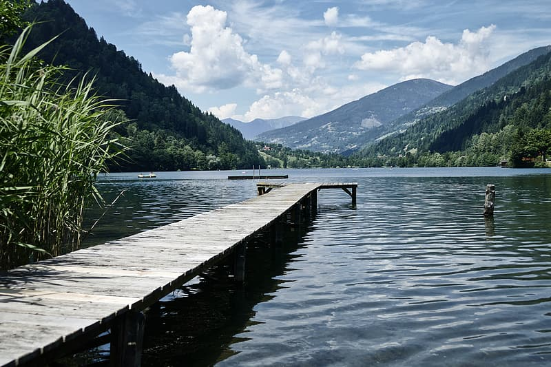 Brown wooden dock on lake during daytime