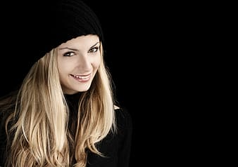Woman wearing black hat smiling