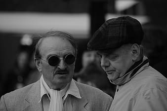 Grayscale photography of two men