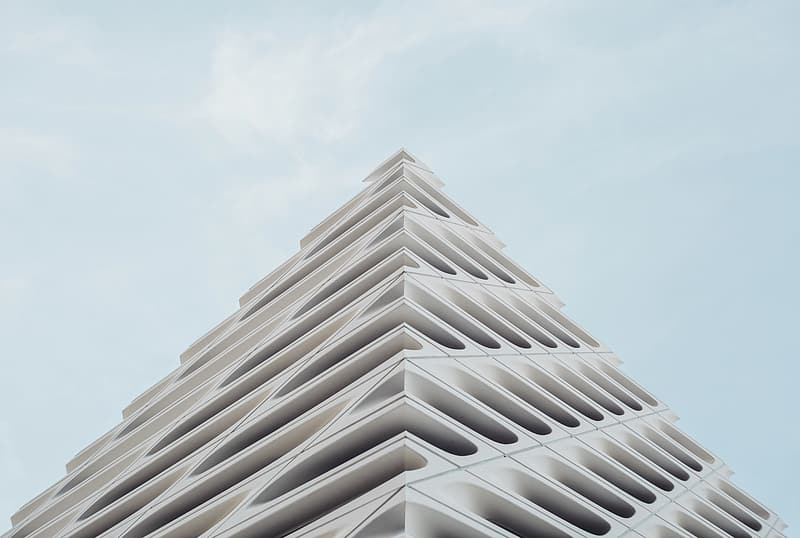 Low-angle photography of high rise building during daytime