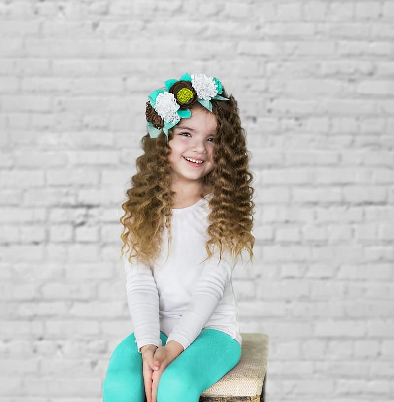 Smiling girl sitting on chair