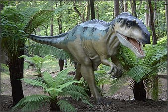 Gray and black T-rex statue on forest