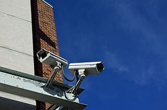 Two white surveillance camera