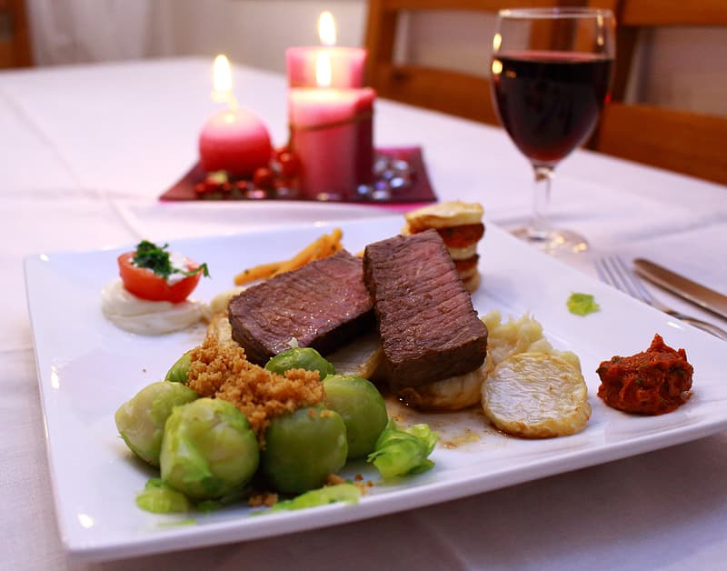 Cooked foods on square white plate