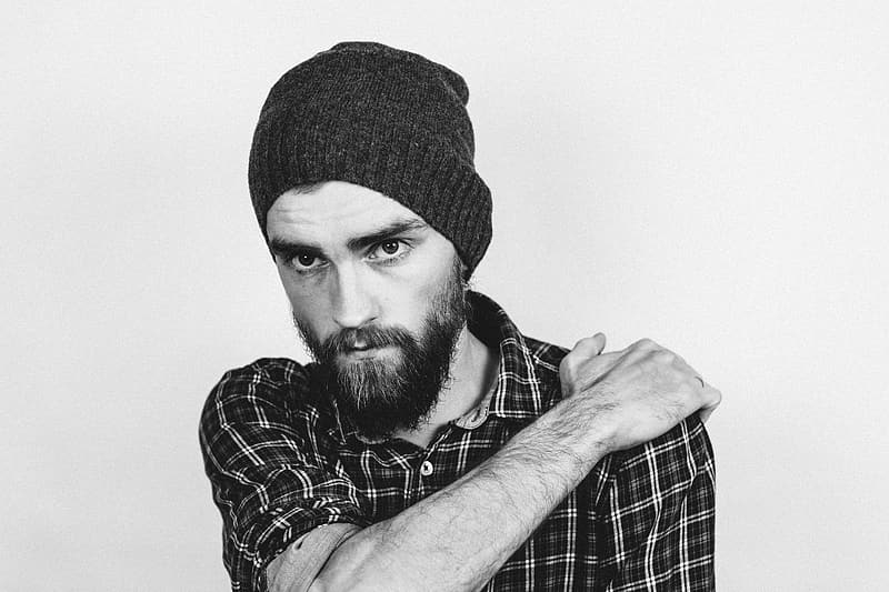 Man wearing gingham sport shirt and black knitted cap