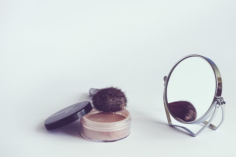 Makeup brush beside vanity mirror