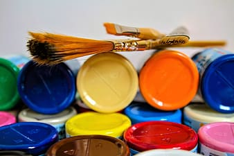 Photography of paint brush on cans