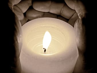 Person holding pillar candle