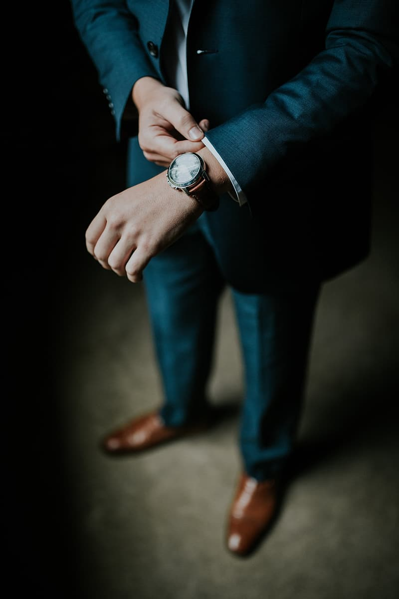 Man wearing blue suit jacket with watch