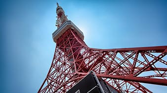 Low-angle photography of red tower