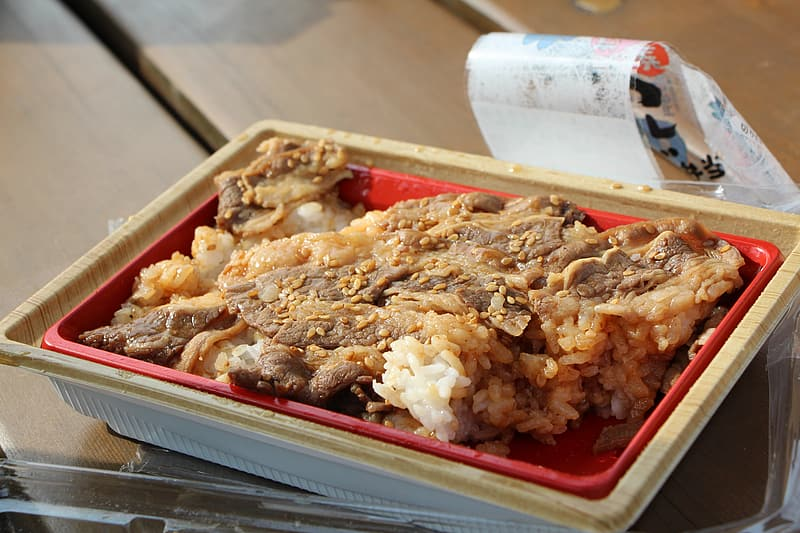 Cooked food in white plastic container