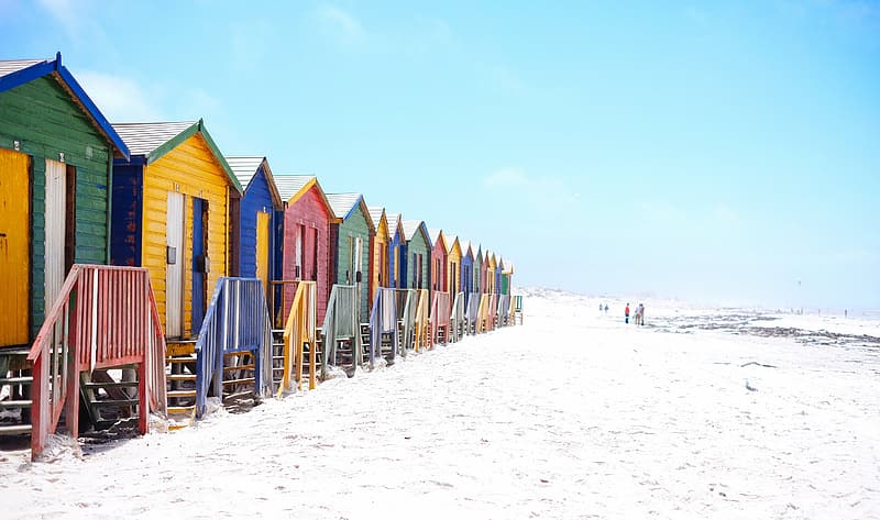 Assorted-colored wooden cottages on seashore