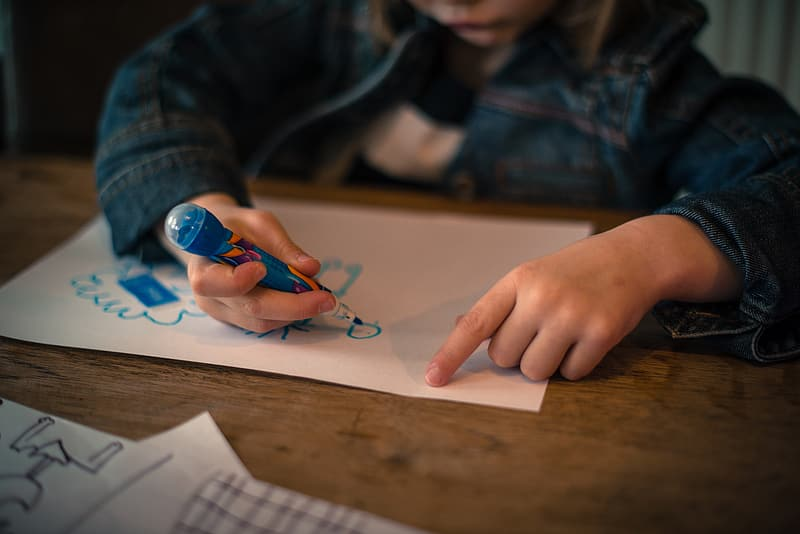 Child drawing on white printing paper