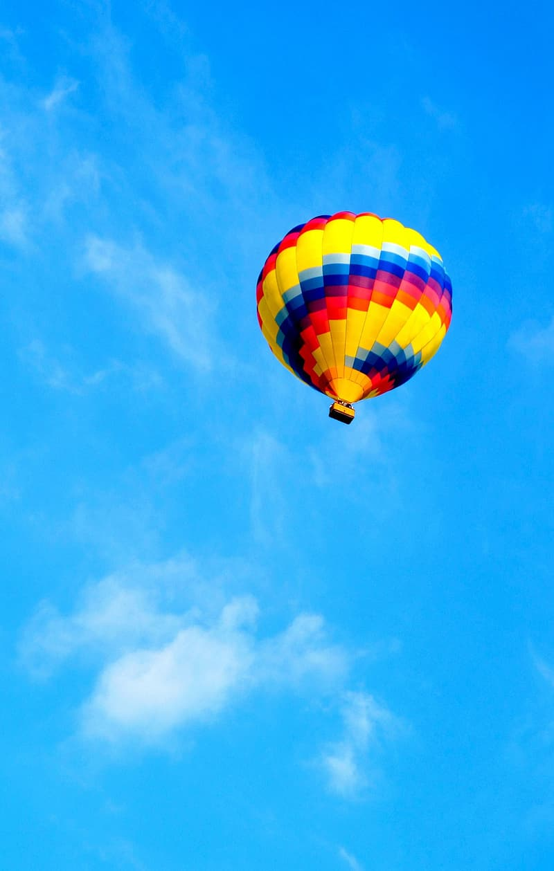 Yellow and red hot air balloon on air
