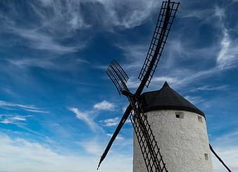 White and black windmill tower during daytime