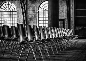 Grayscale photography of armless chairs