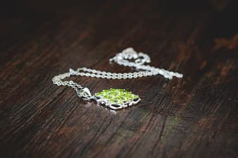 Silver-colored green gemstone pendant necklace
