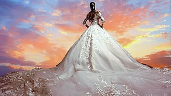 Woman with white ball water gown under yellow sky during daytime time lapse photo