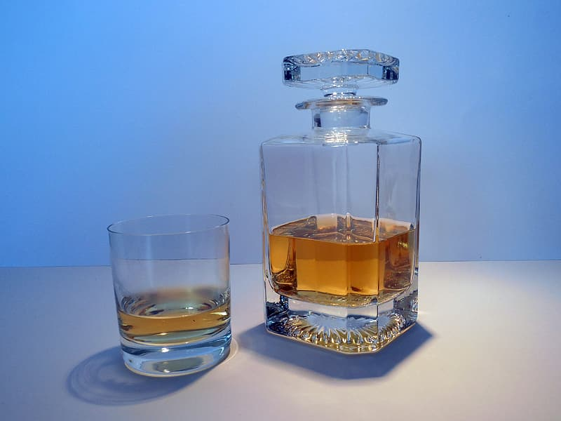 Clear glass decanter and rocks glass filled with whisky