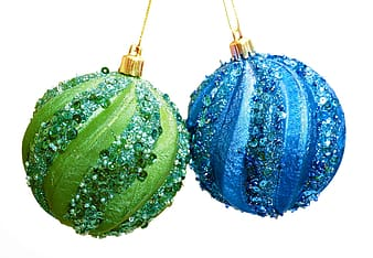Green and white floral christmas baubles
