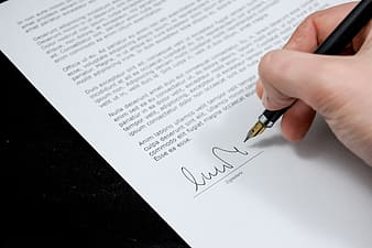 Person holding signature pen