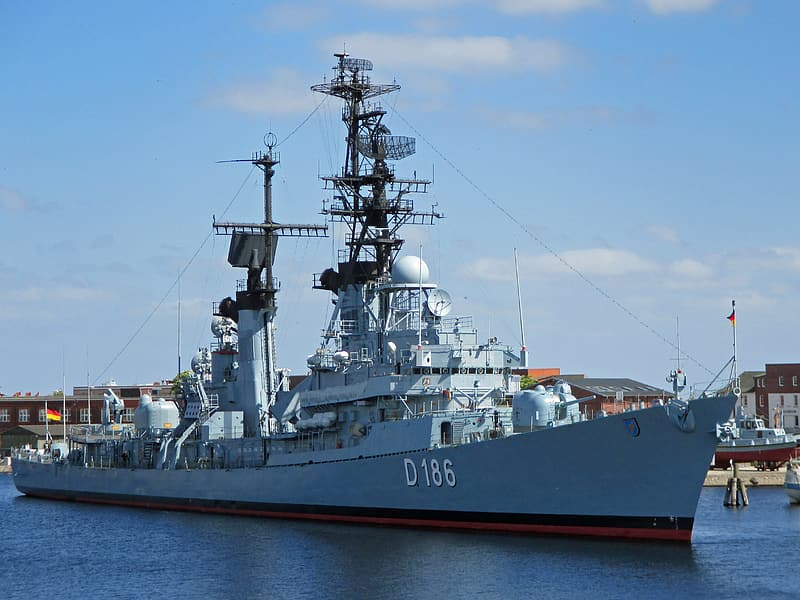 Gray and white D186 ship on body of water