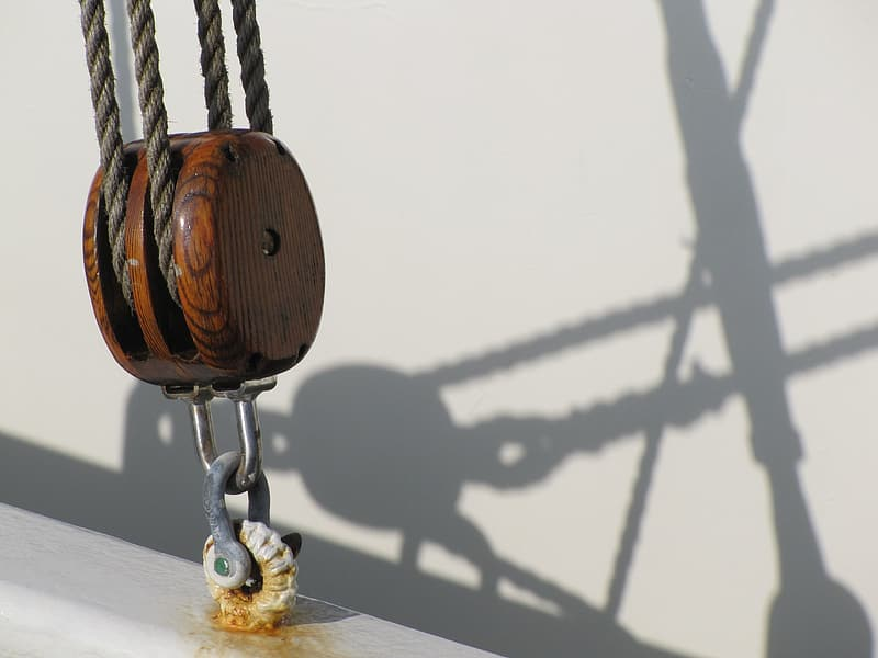 Brown wooden round pendant on brown wooden table
