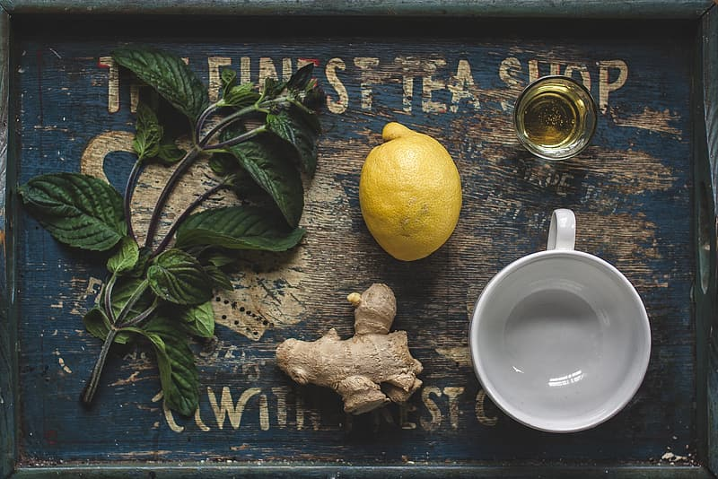 Lemon and ginger on gray wooden tray