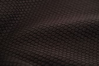 Red and black textile in close up photography