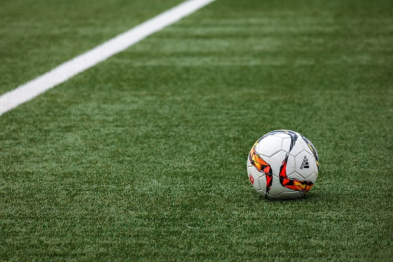 Soccer ball on the field photo