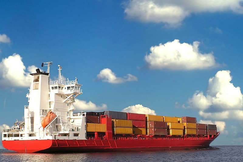 White and red cargo ship