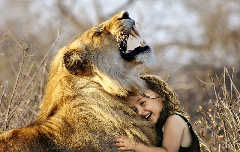 Girl embracing lion
