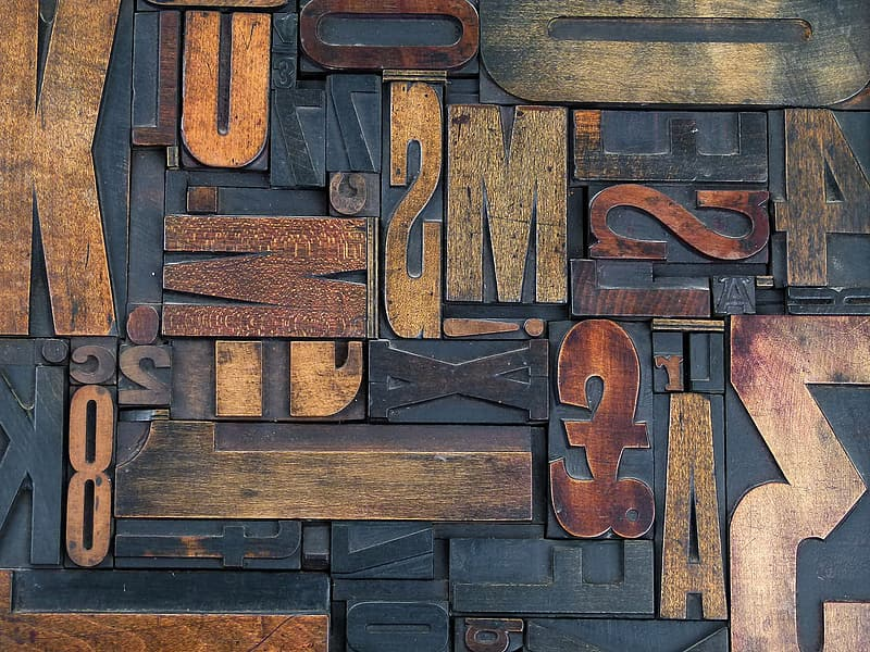 Closeup of numbers and letters wood carvings