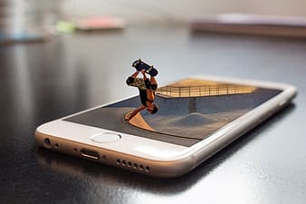 Person skateboarding on silver iPhone 6 graphic illustration
