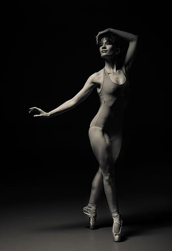 Woman ballet dancing in grayscale photography