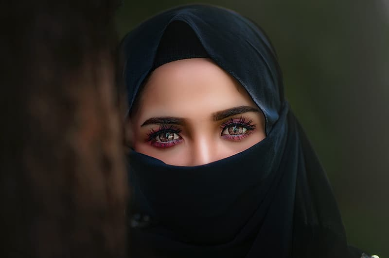 Woman in black hiqab viel in shallow focus photography