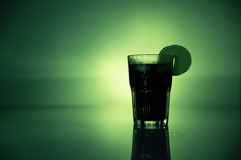 Drinking glass filled by juice photograph