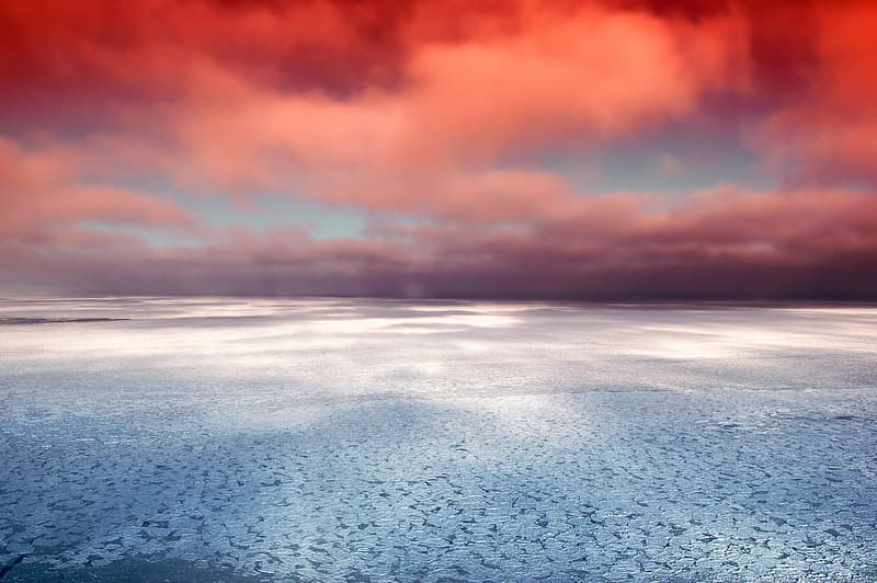 Grey sand under red cloudy sky