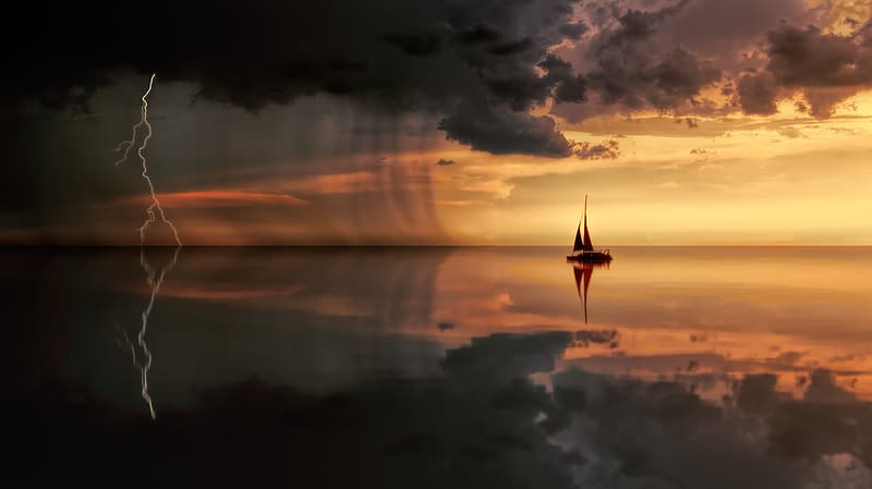 Silhouette photo of ship on sea under nimbus clouds
