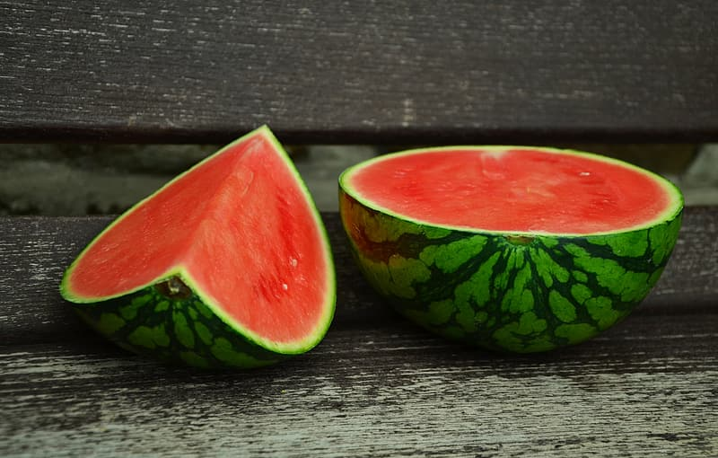 Food photography of two sliced watermelons