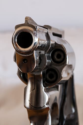 Close up photo of gray revolver