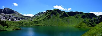 Landscape photography of green mountain with lake at day time