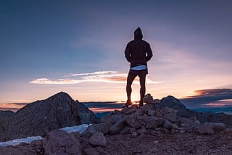 Person standing on rocking ground during dawn