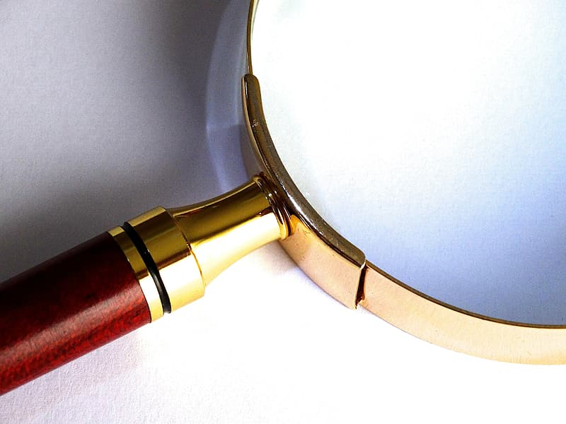 Silver and red magnifying glass