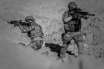 Grayscale photo of two armies