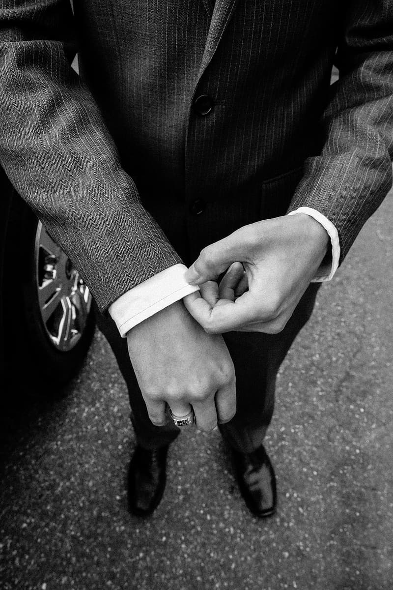Grayscale photography of man in black suit close up photo