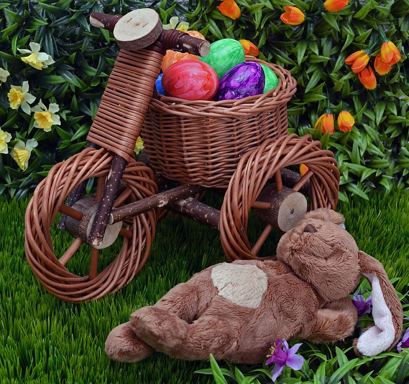 Brown wicker bicycle toy and brown bear plush toy