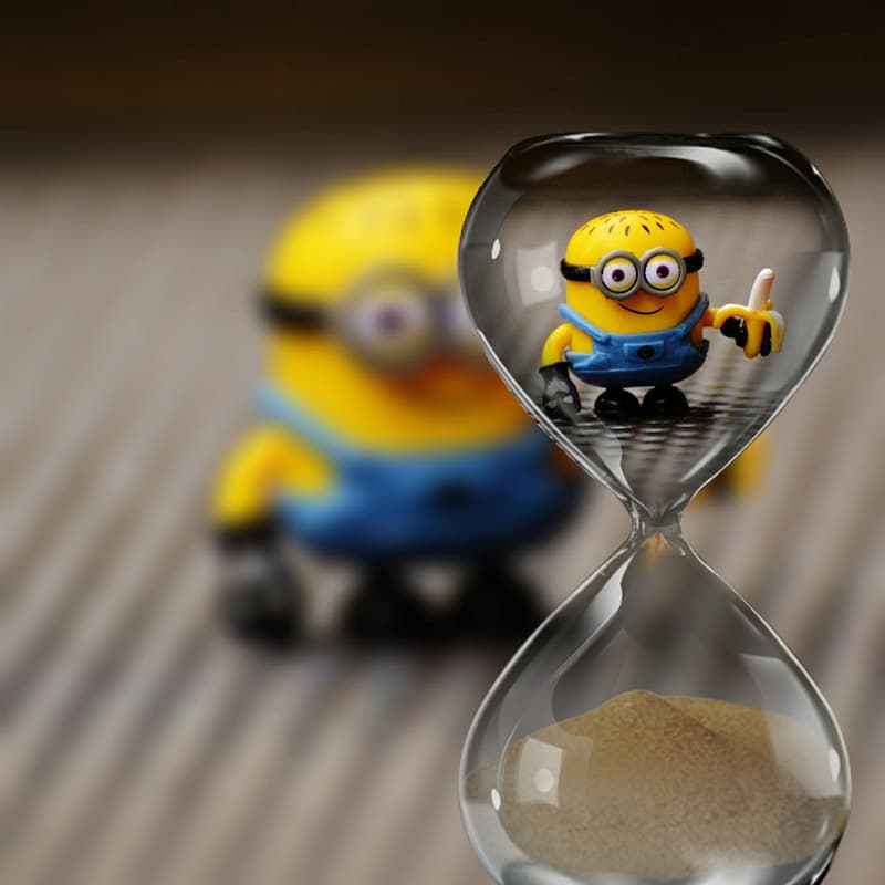 Hourglass with minion action figure background
