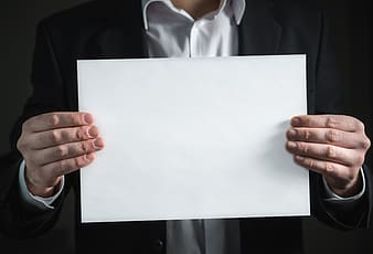 Person holding white printing paper