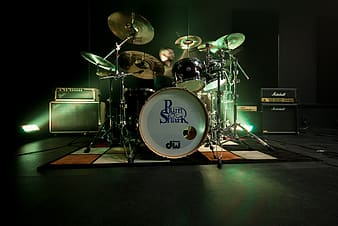 Black and brass-colored drum set